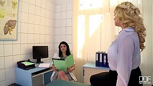 Buxom Blonde slut gets fisted hard in the doctors Office